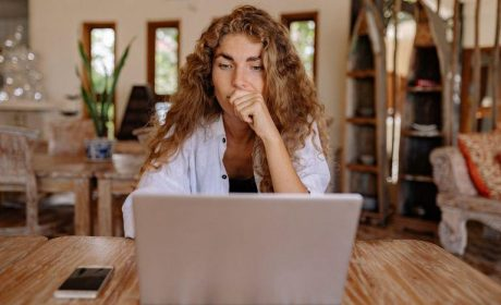 Woman sitting at the table in front of her laptop