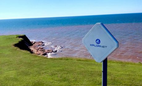 Photograph of an Xplornet Access Point mountain edge by the ocean by Dylan Murchison