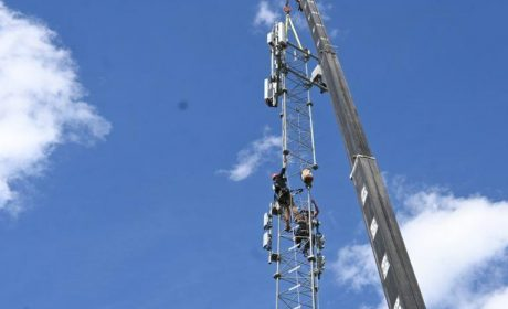 Construction workers working on a communications tower