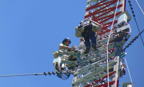 Working up a communications tower carrying out construction