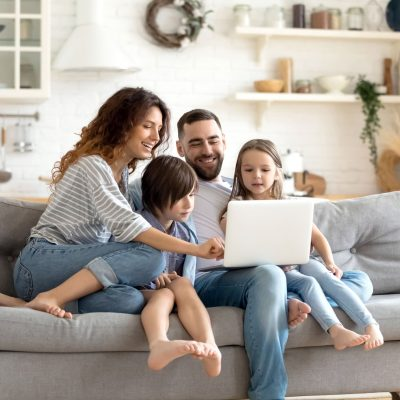 A family enjoying a reliable internet connection on their sofa.