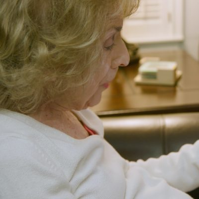 A woman communicating with her doctor over a tablet.