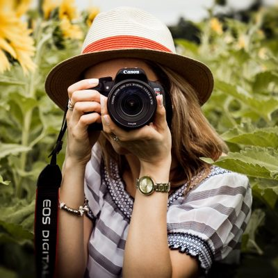 An image of a woman with a camera raised to her eye.